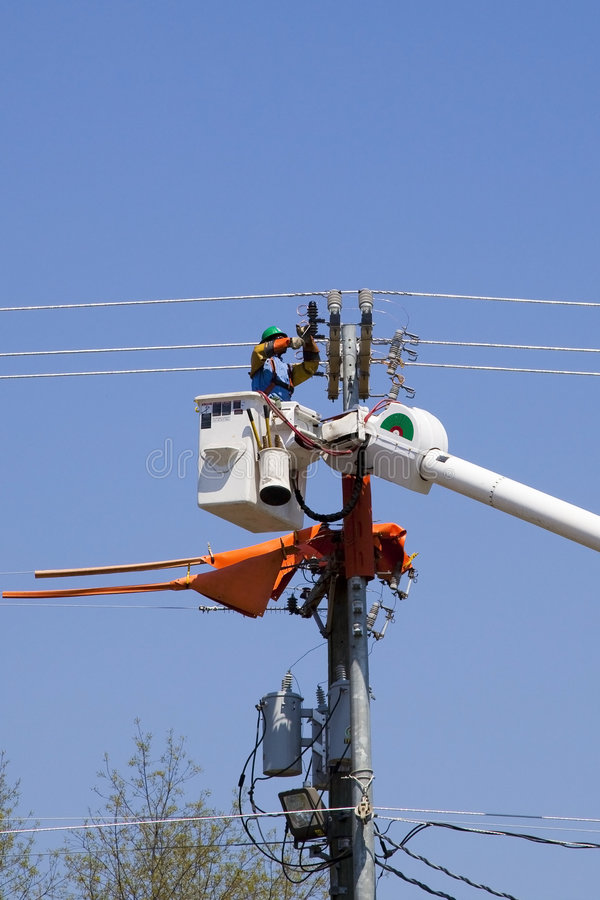 High lines construction. Contractors installing new high voltage transmission towers to carry electricity across the country, parts are lifted with a large crane stock photography