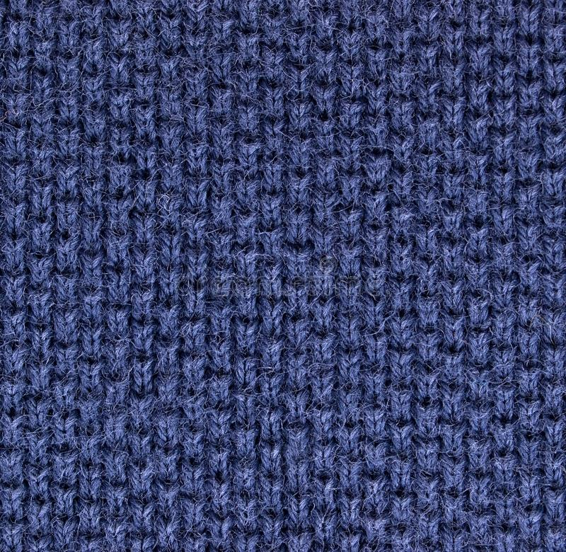 High magnification polo shirt fabric knit texture. Blue polo shirt fabric knit texture. high magnification. perpendicular knit line stock images