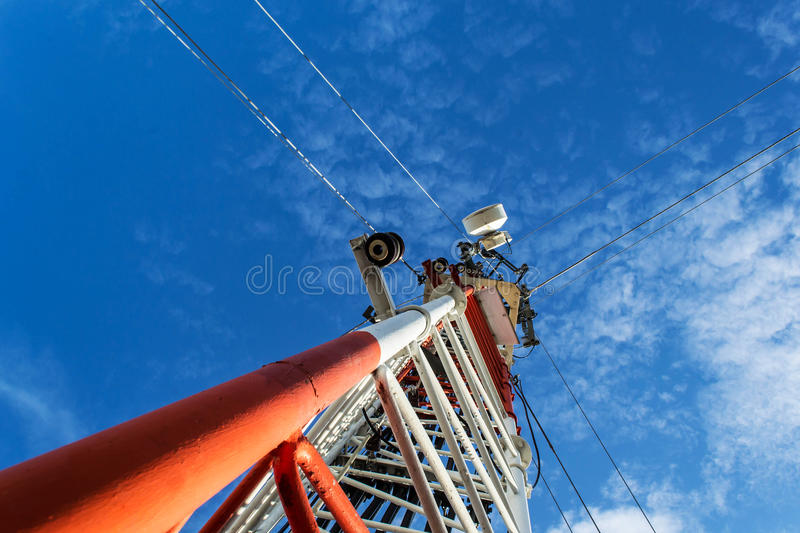 High mast metal structure telecommunication on tower with blue s. Ky stock photography