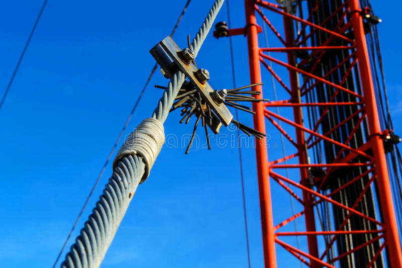 High mast metal structure telecommunication on tower with blue s. Ky stock photo