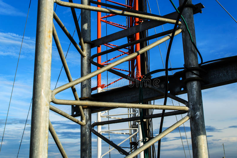 High mast metal structure telecommunication on tower with blue s. Ky royalty free stock photography