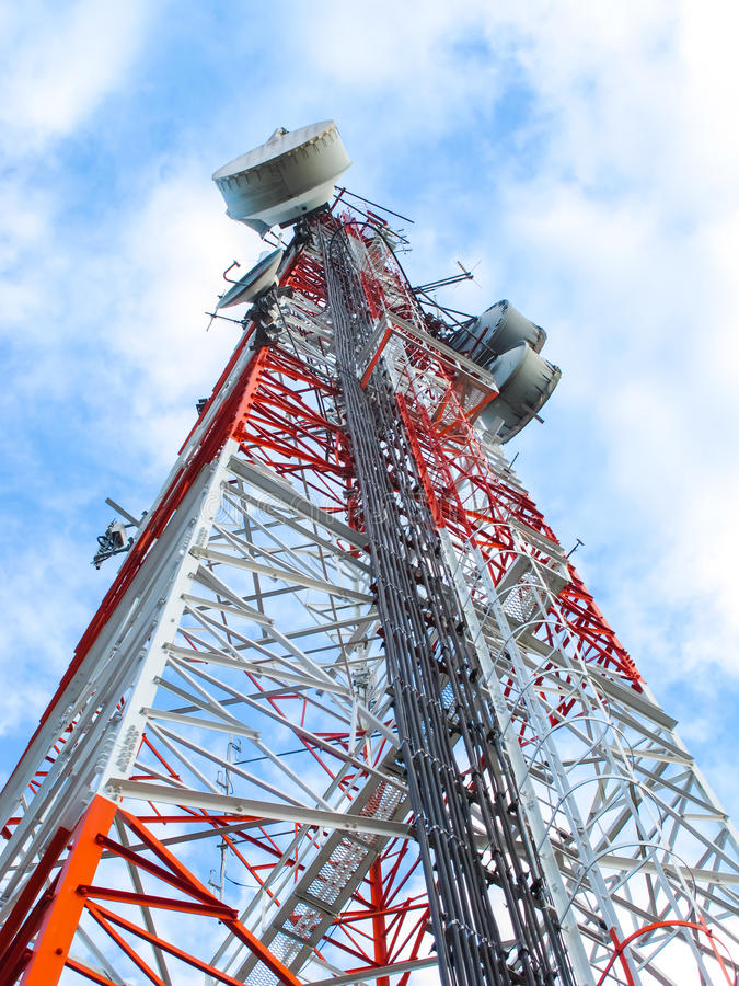 High microwave mobile pole station with blue sky. Telecommunication industry royalty free stock image