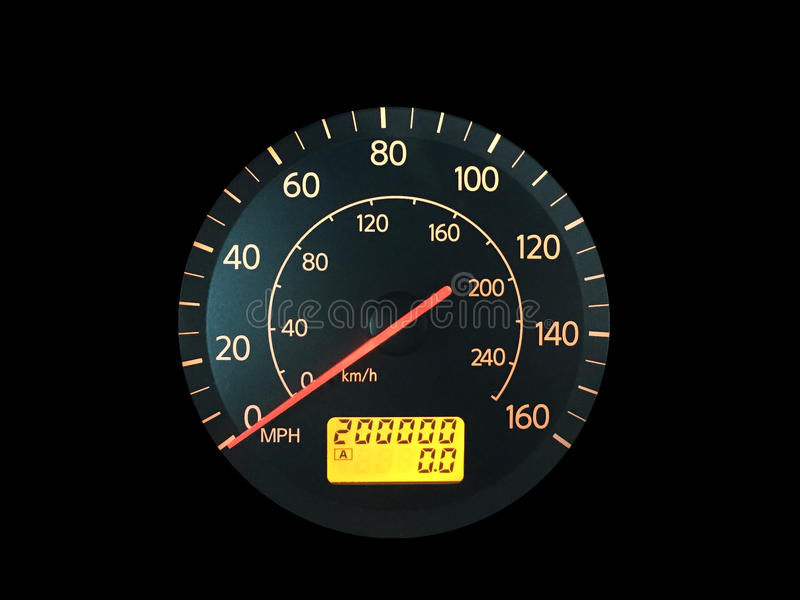 High Mileage Odometer on Black. Photograph of a car speedometer with exactly 200,000 miles on the odometer. on black. Concepts could include age, reliability stock photo
