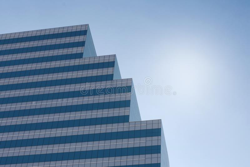 A high modern tower standing against sky in midday royalty free stock photo