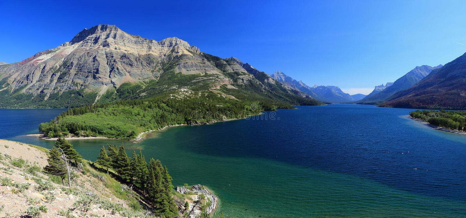 Panorama of Upper Waterton Lake and Vimy Peak from Prince of Wales Hotel, Waterton Lakes National Park, Alberta, Canada. From the high moraine near the historic stock photo