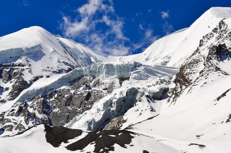 High mountain glacier and snow peaks and slopes royalty free stock images
