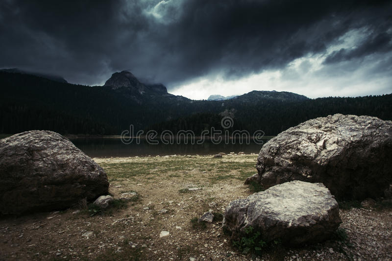 High mountain and lake at cloudy daytime. Beautiful nature landscape royalty free stock images