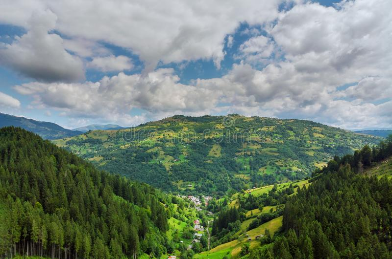 High mountain panorama drone fly above the mountains In summer. Aerial View Above in the Carpathian Mountains And Meadows stock images