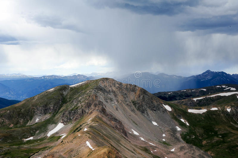 High Mountain Ridge. Looking down the ridge of some high peaks in the rocky mountains with storms approaching stock photography