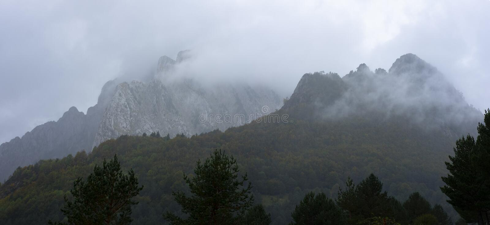 High mountain surrounded by myst. This mountain is located in Pyrenees royalty free stock photo