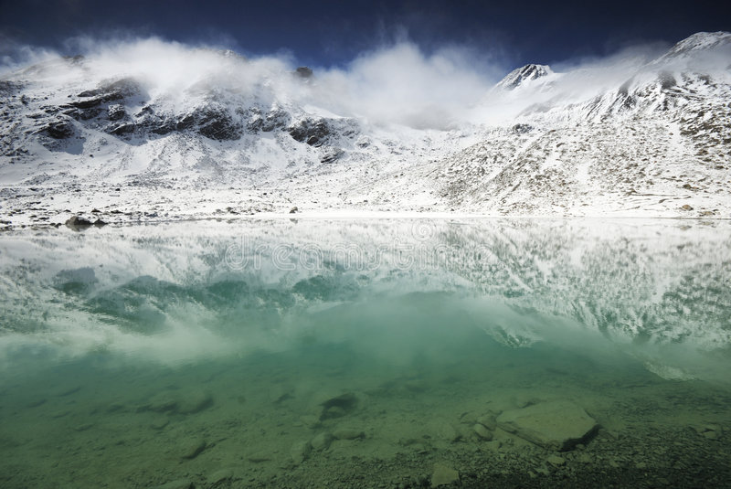High mountaines Lake. Clear lake in alpine mountains stock image