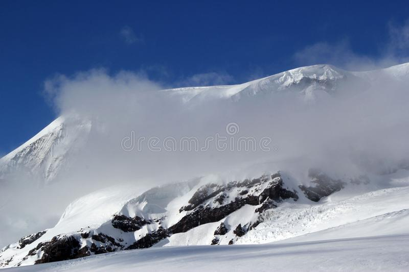 High mountains off-piste slopes for freeride with traces of skis and snowboards, sunny winter day, Caucasus Mountains, Elbrus royalty free stock photos