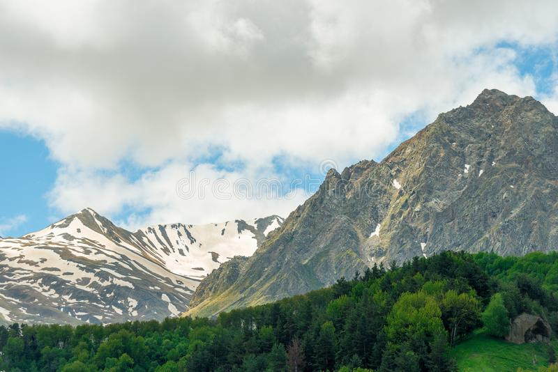 High mountains with remnants of snow on top in Georgia in summer royalty free stock images