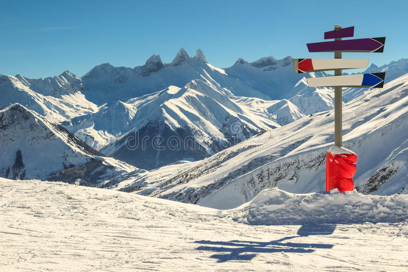 High mountains and signboard in the Alps,Les Sybelles,France. Famous ski resort in the French Alps,Les Sybelles,France royalty free stock photo