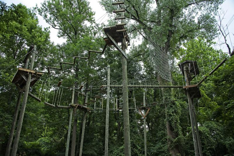 High Obstacle Course in the Trees. Elevated Ropes and climbing obstacle course used for team building, skill building and recreation stock photography