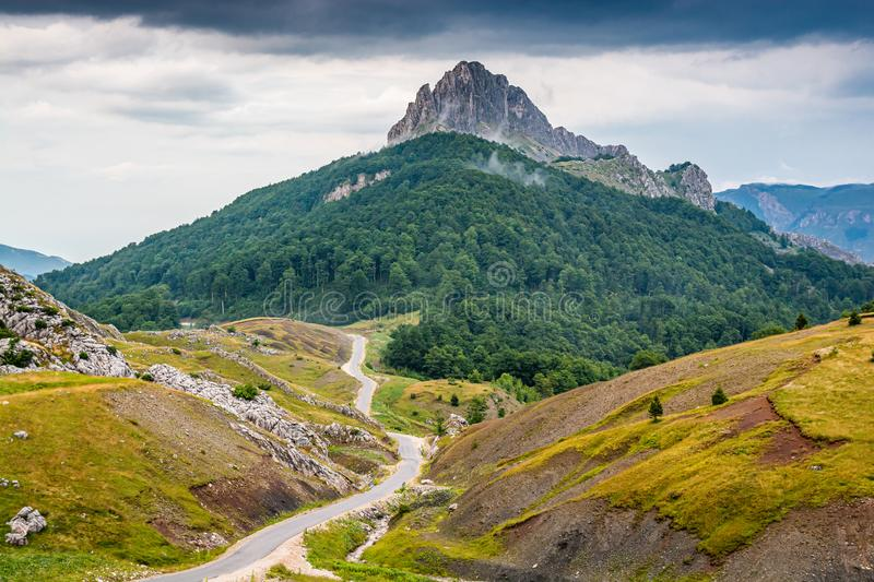 High peak Puzim with tar road in Bosnia and Herzegovina.  stock images