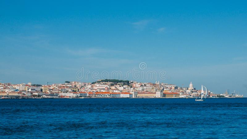 High perspective panorama of Lisbon old city center, view from Almada, Portugal.  stock photo