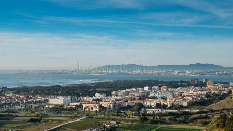High perspective view of Greater Lisbon from Miradouro Aldeia dos Capuchos in Costa de Caparica. Almada. Palacio Pena in Sintra is visible in far right royalty free stock image