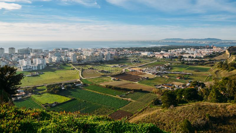 High perspective view of Greater Lisbon from Miradouro Aldeia dos Capuchos in Costa de Caparica. Almada. Palacio Pena in Sintra is visible in far right stock photos