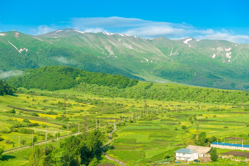 High picturesque mountains with snow on top and green lush meadows beautiful landscape of Armenia. From a height royalty free stock photos