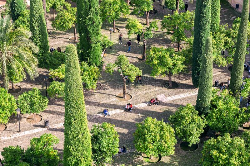 High point view on green garden of historical Mesquita in Cordoba. People relaxing outdoor in Andalusia, Spain stock photography