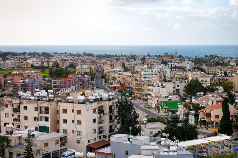 High point view to Paphos city with houses, sea and sky stock photography