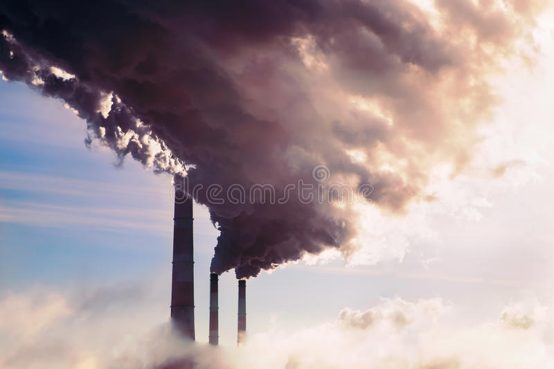 High pollution from coal power plant. Smoking chimney. stock image