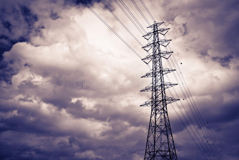 High power electrical pole. On a cloudy day with silhouette stock photos