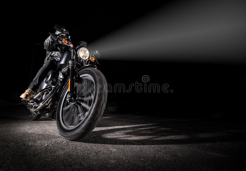 High power motorcycle chopper at night. High power motorcycle chopper at night with shinning light royalty free stock photography