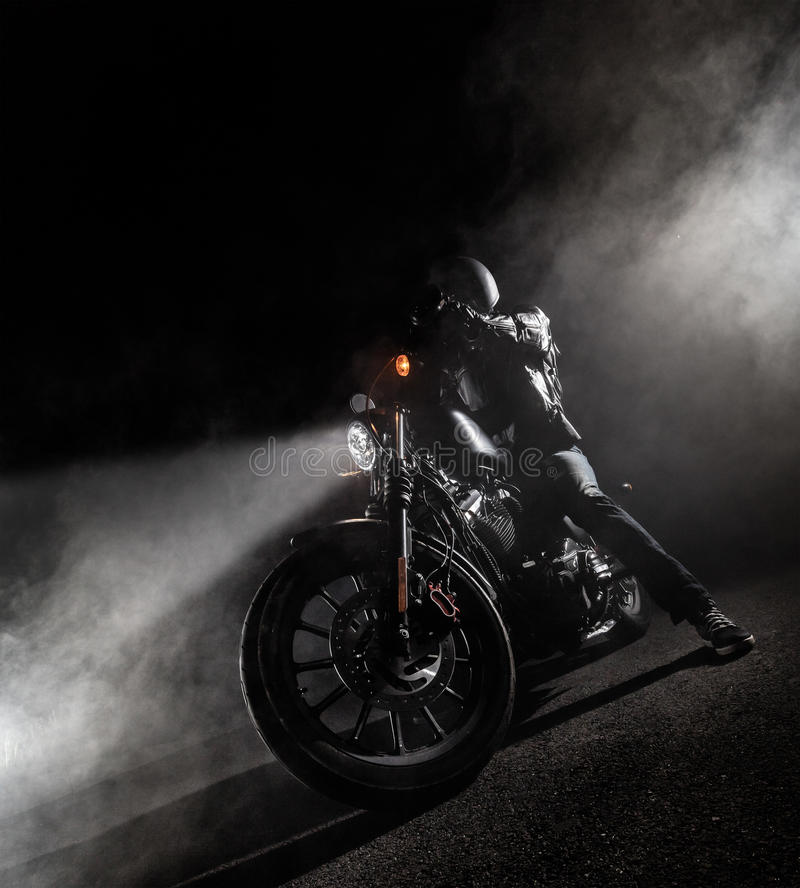 High power motorcycle chopper at night. stock images