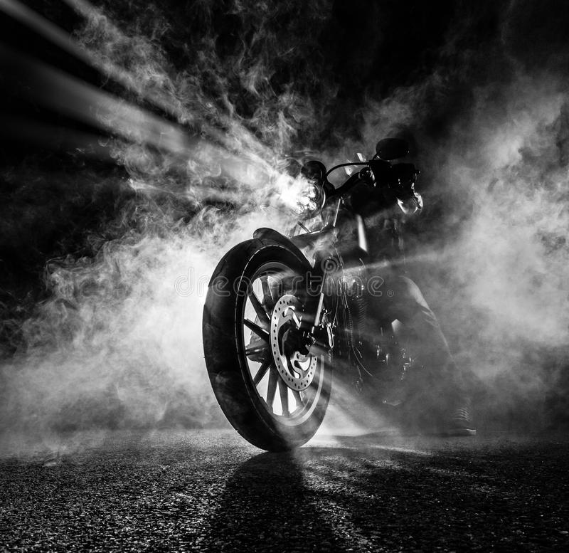 High power motorcycle chopper at night. Smoke on background royalty free stock photos