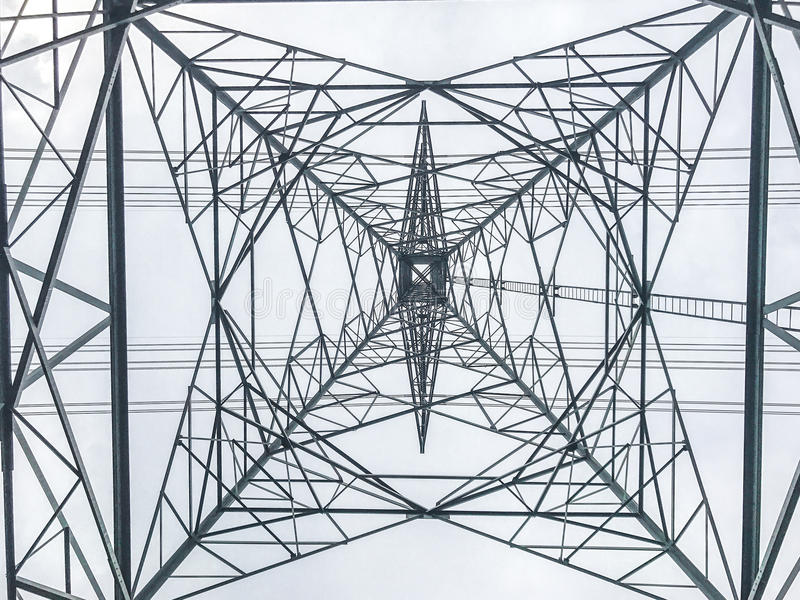 High power pylons and natural green with clear skies. stock photo