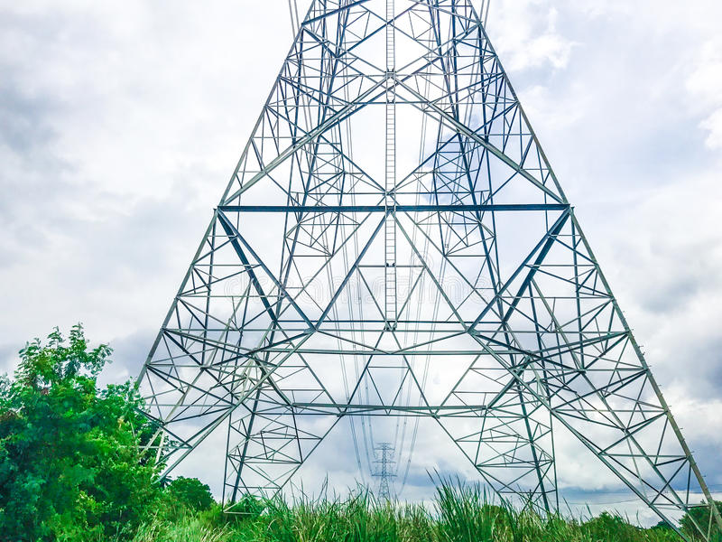 High power pylons and natural green with clear skies. royalty free stock images