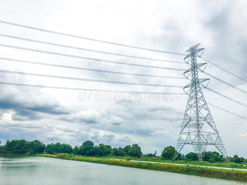 High power pylons and natural green with clear skies. royalty free stock photography