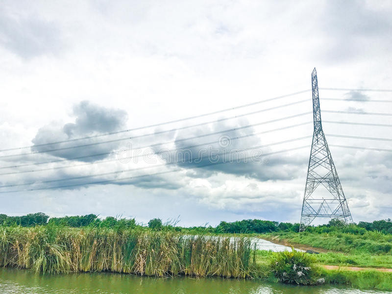 High power pylons and natural green with clear skies. stock photos