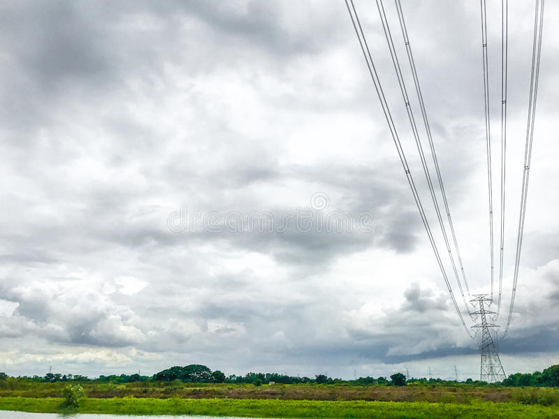 High power pylons and natural green with clear skies. royalty free stock image