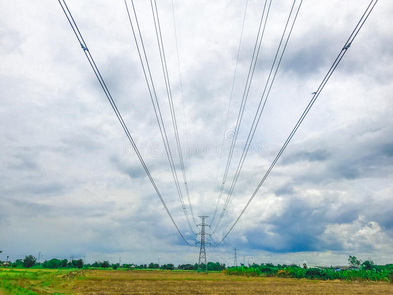 High power pylons and natural green with clear skies. stock photography