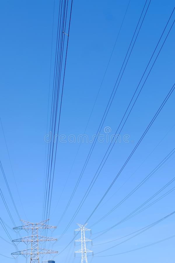 High power transmission towers. The power plant must raise the voltage to the high voltage power to carry the electricity in a long distance. The dangerous high stock photo