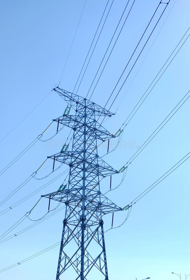 High power transmission towers. The power plant must raise the voltage to the high voltage power to carry the electricity in a long distance. The dangerous high royalty free stock photography