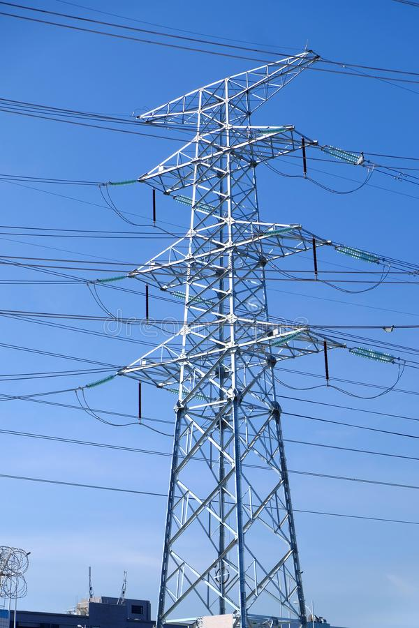 High power transmission towers. The power plant must raise the voltage to the high voltage power to carry the electricity in a long distance. The dangerous high stock photography