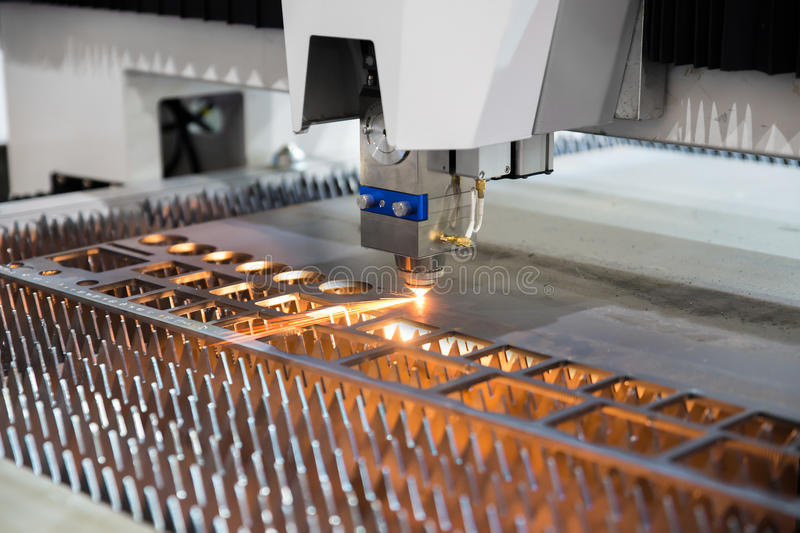 High precision CNC gas cutting metal sheet working in industry f stock photography