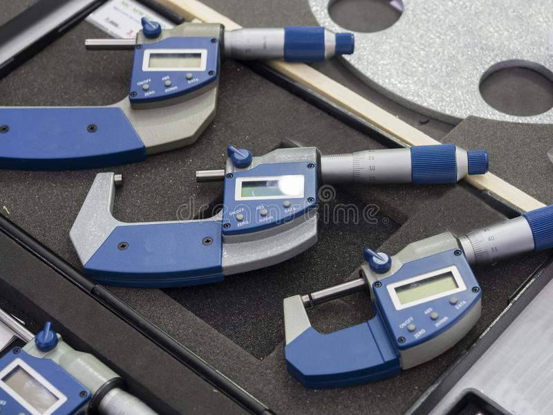 High precision mocro meter for industrial quality inspection. Operator inspection high precision automotive part by micrometer royalty free stock photo