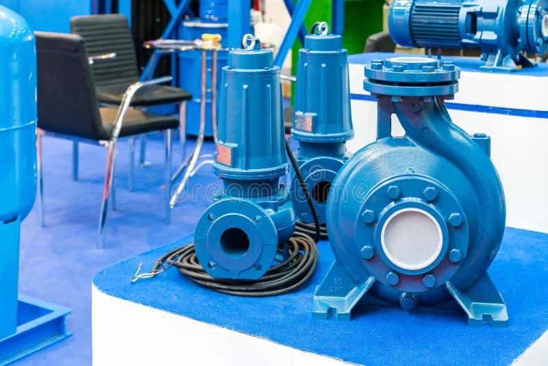 High pressure Centrifugal blue pump include motor on table. Close up High pressure Centrifugal blue pump include motor on table stock photos