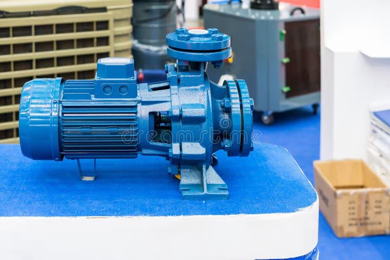 High pressure Centrifugal blue pump include motor on table. Close up High pressure Centrifugal blue pump include motor on table royalty free stock photos