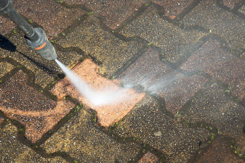 High Pressure Cleaning washer professional services cleaner sidewalk. A High Pressure Cleaning washer professional services cleaner sidewalk stock photo