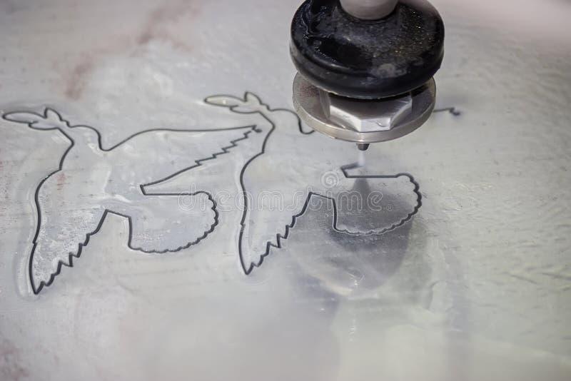 High pressure waterjet aluminium cutting 2 stock photos