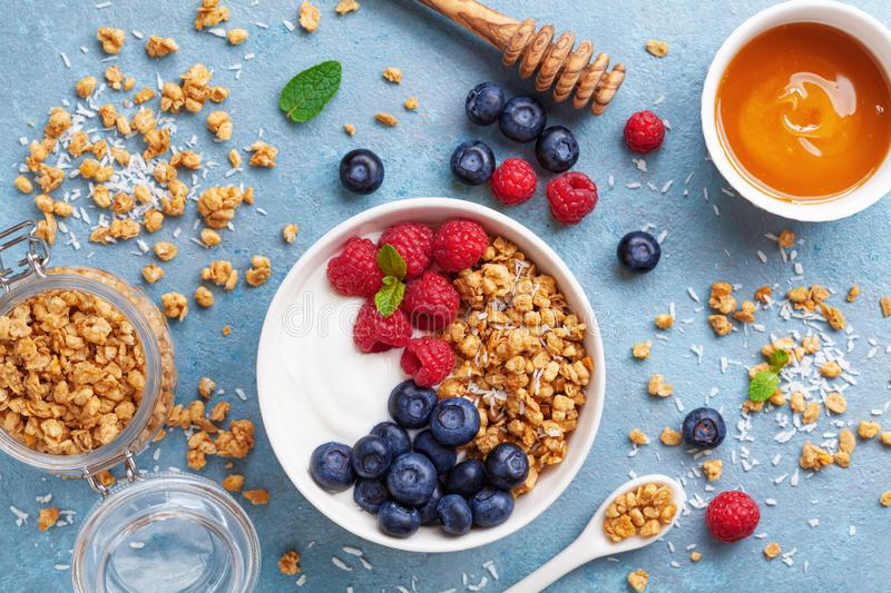 High protein and diet breakfast. Homemade granola crisp with raspberry, blueberry and greek yogurt. High protein diet breakfast. Homemade granola crisp with royalty free stock photo