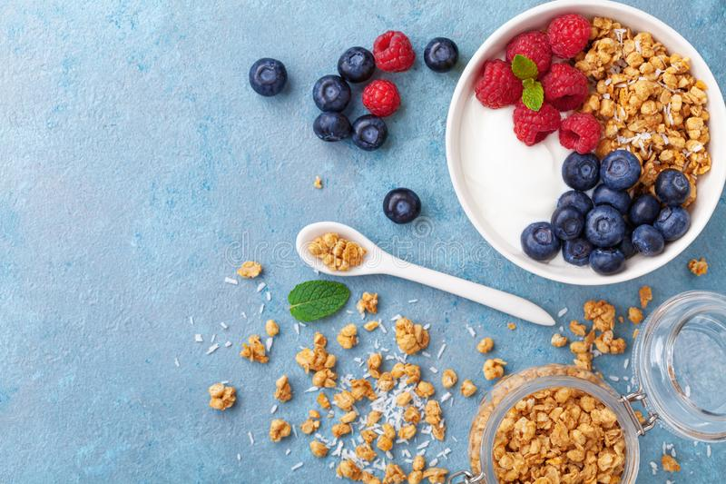High protein and diet breakfast. Homemade granola crisp with raspberry, blueberry and greek yogurt. Top view. High protein and diet breakfast. Homemade granola royalty free stock image
