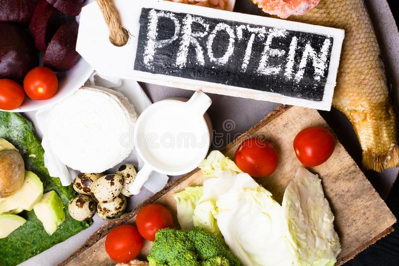 High protein food - fish, meat, sea slug, shrimps, eggs, cabbage, beet, broccoli, spinach, tomatoes, avokado, salmon. Products goo stock photos