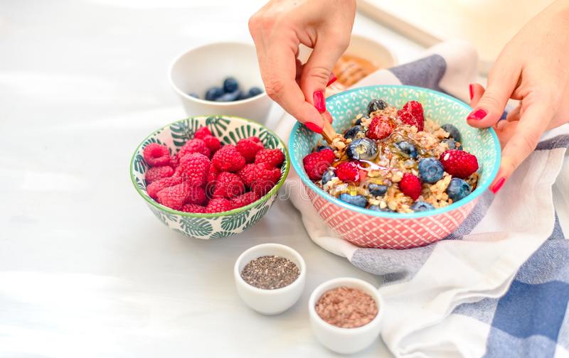 High protein healthy breakfast, buckwheat porridge with blueberries, raspberries, flax seeds and honey Closeup view, selective foc. High protein healthy stock image